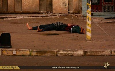 gruesome-photos-show-islamic-state-executing-gay-men-throwing-them-tall-building-body-.jpg