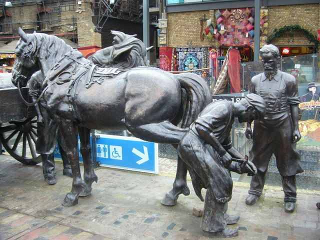 Stables_Market_shoeing_a_horse_sculpture_-_geograph.org.uk_-_1712759.jpg