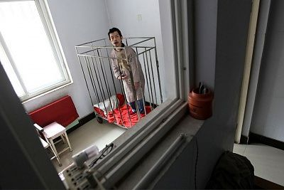 chinese-man-kept-cage-40-years-main-2921825.jpg