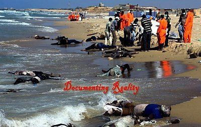 dead-african-immigrants-wash-up-on-beach-after-boat-sinks-2-Qarboli-LY-aug-26-14_jpg-large.jpg