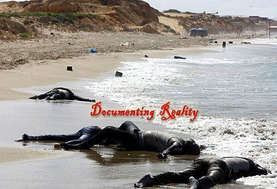 dead-african-immigrants-wash-up-on-beach-after-boat-sinks-8-Qarboli-LY-aug-26-14_jpg-large.jpg