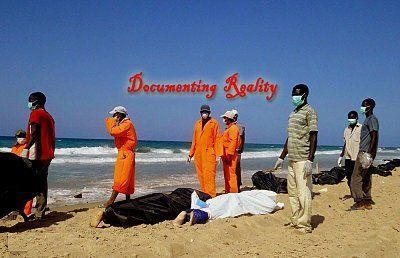 dead-african-immigrants-wash-up-on-beach-after-boat-sinks-10-Qarboli-LY-aug-26-14_jpg-large.jpg